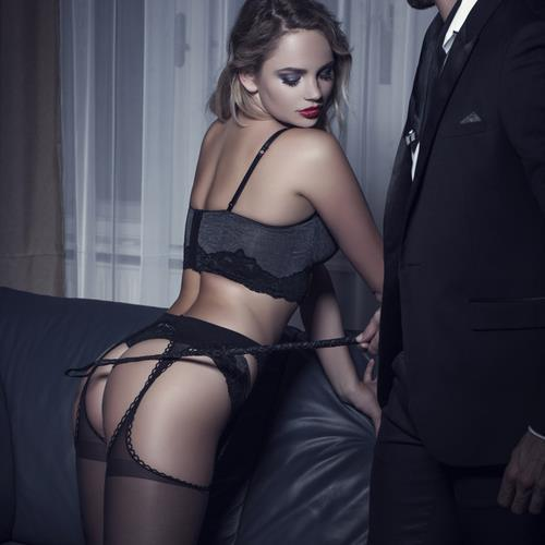 BDSM submissive, wearing black lingerie